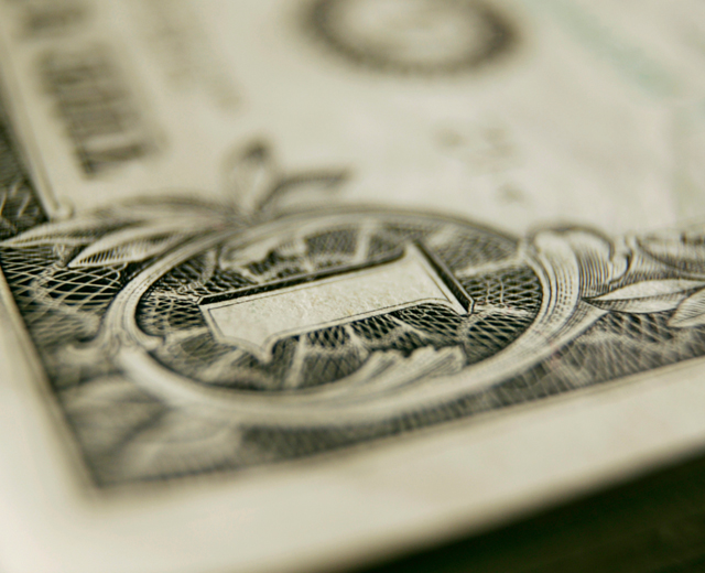 close up image of a one dollar bill