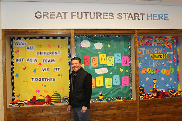 Ken Scott in front of bulletin boards image