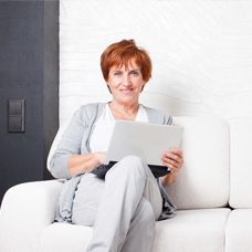 image of women sitting with a laptop