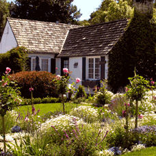 Image of house with flowers in yard