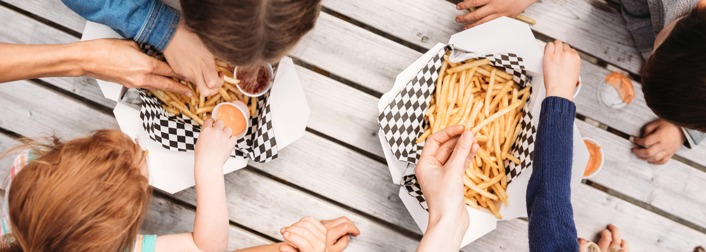 Image of people eating fries.